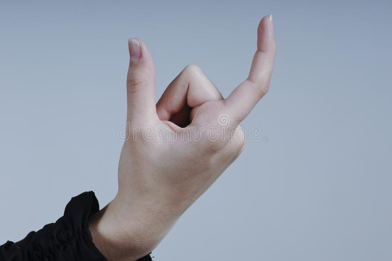 Carte d'isolement par participation femelle de main avec deux doigts photographie stock