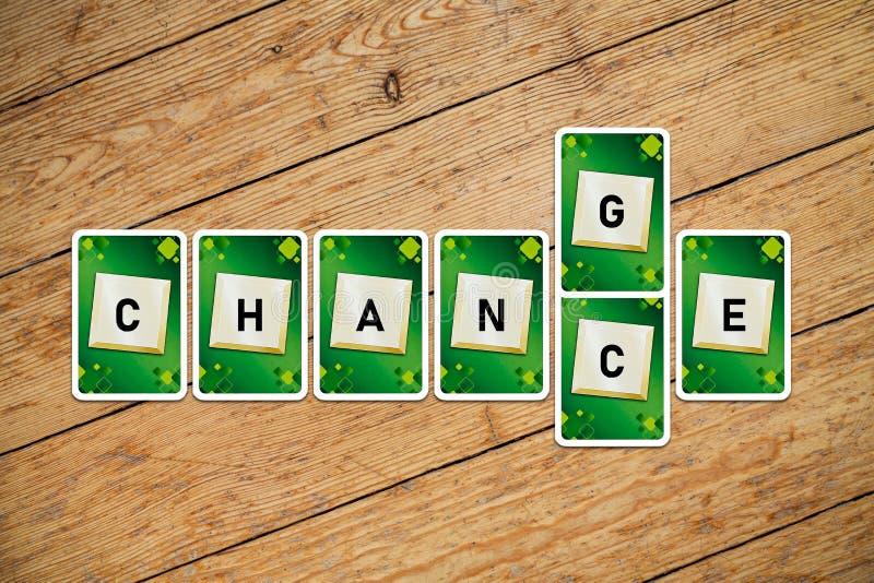 """Carte da gioco con le cambiamento-probabilità del testo """"su un pavimento di legno fotografie stock libere da diritti"""