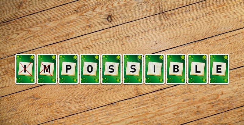 """Carte da gioco con testo """"impossibile """"su un pavimento di legno fotografia stock libera da diritti"""
