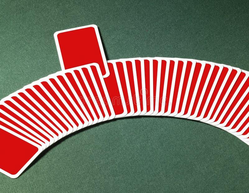 Carte da gioco in una fila immagini stock libere da diritti