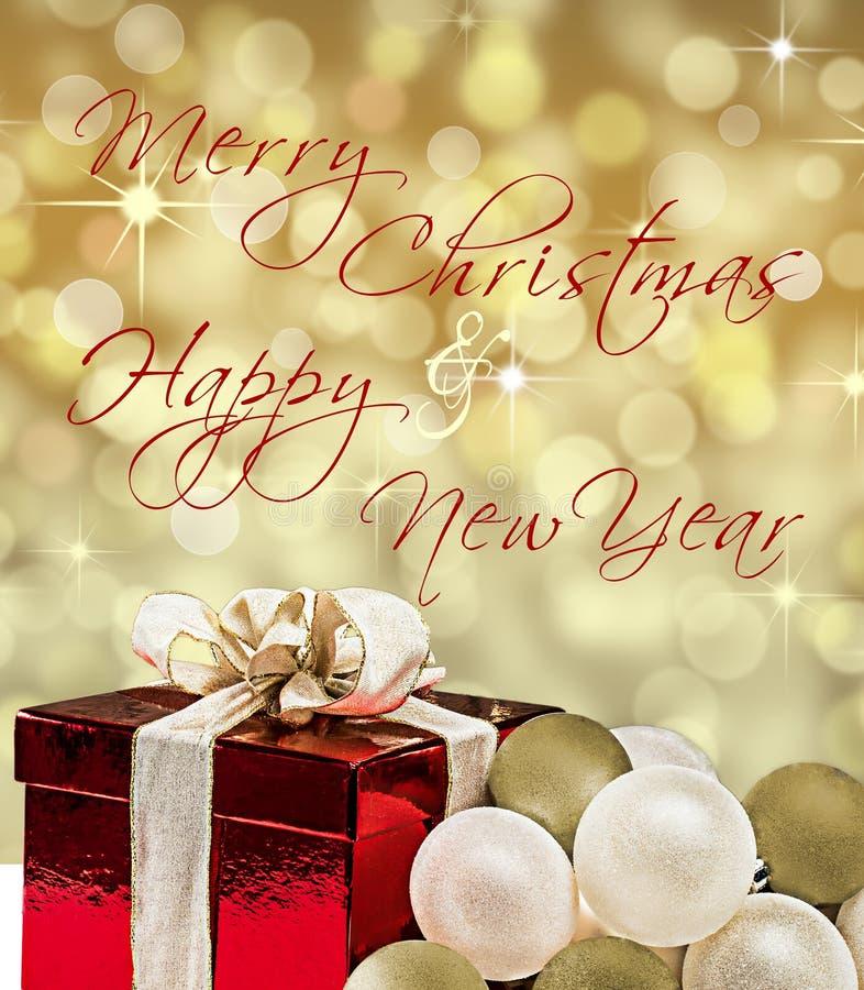 Carte de Joyeux Noël et de bonne année avec le boîte-cadeau photo libre de droits