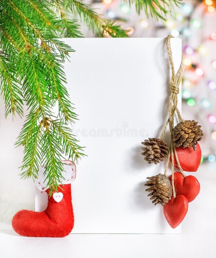 Carte de Noël avec le décor de vacances photo libre de droits