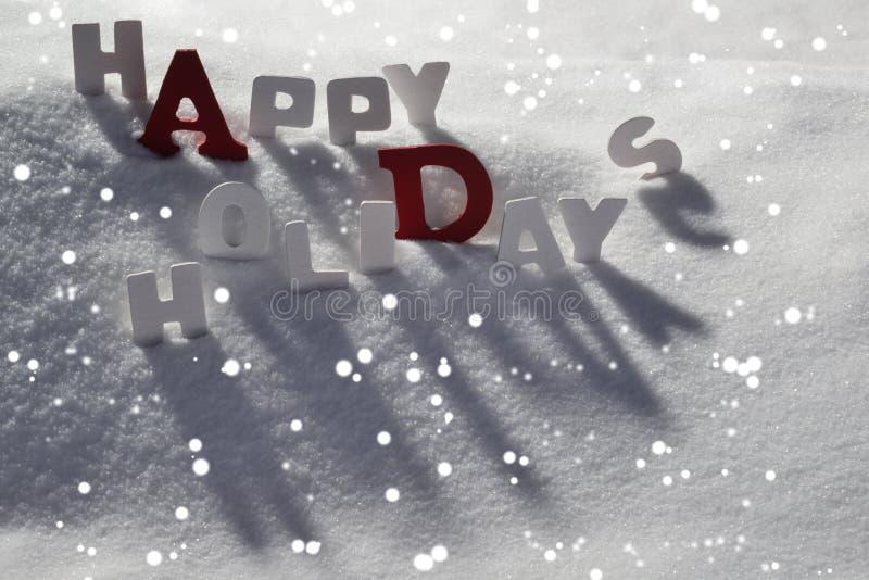 Carte de Noël avec les lettres blanches et rouges, bonnes fêtes, neige images libres de droits