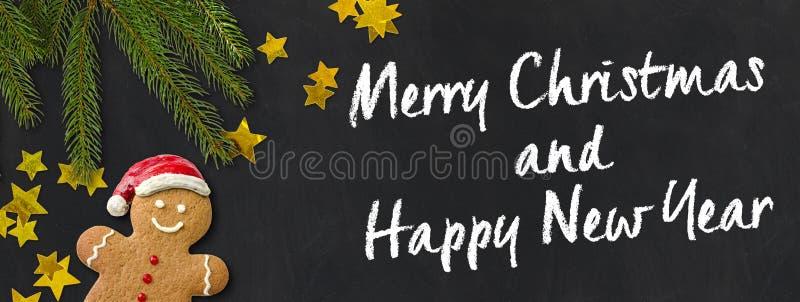 Carte de Noël avec une décoration de bonhomme en pain d'épice et de Noël photos libres de droits
