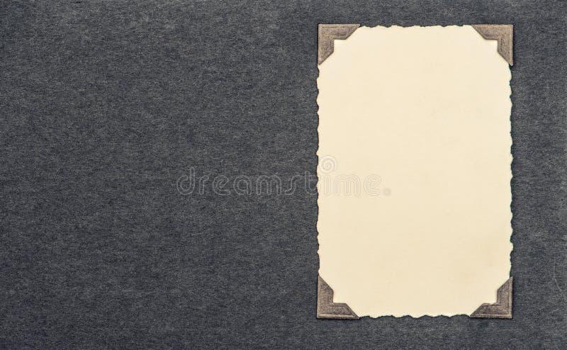 Carte de photo avec le coin au-dessus de la page d'album photo libre de droits