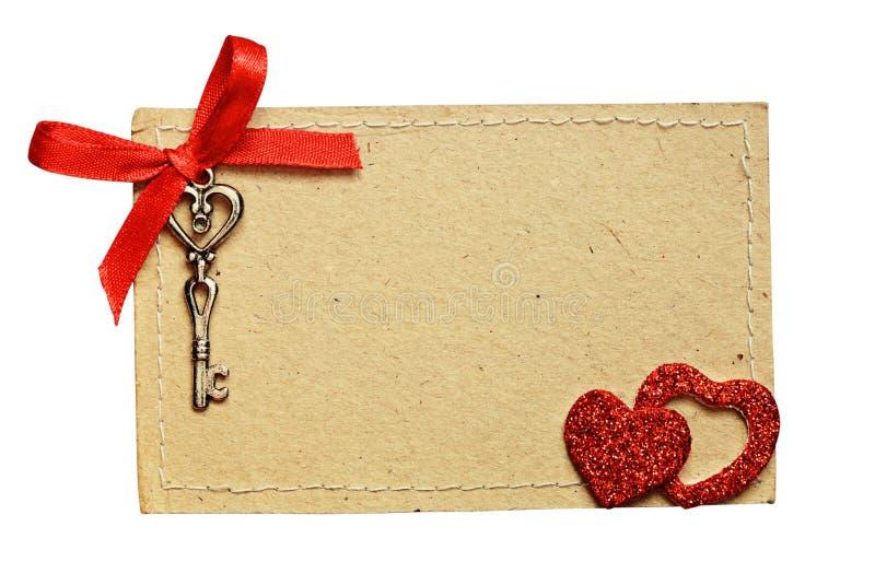 Carte de voeux avec le ruban rouge et une clé pour le jour du ` s de Valentine photo stock