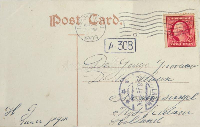 Carte postale de vintage avec le timbre-poste et l'adresse américains dans Rott photo libre de droits