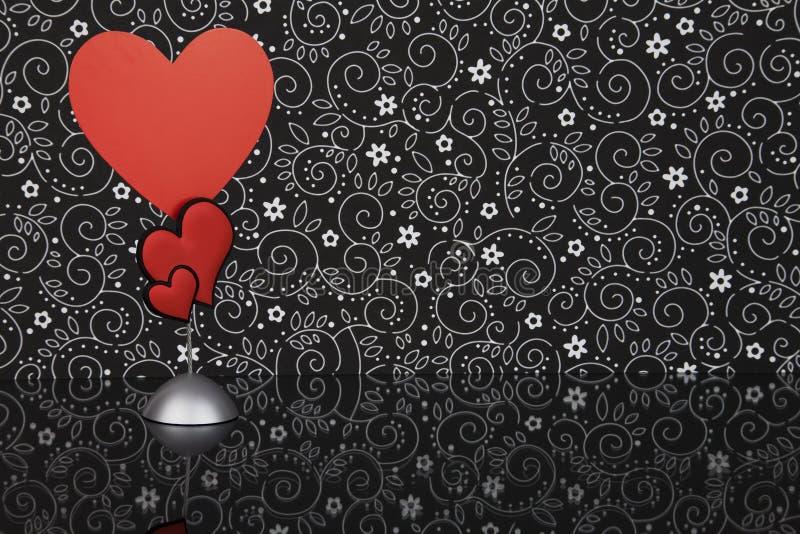 Carte rouge de forme de coeur image stock