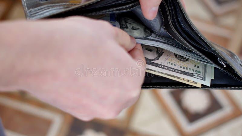 Carteira com dólares americanos para dentro imagem de stock