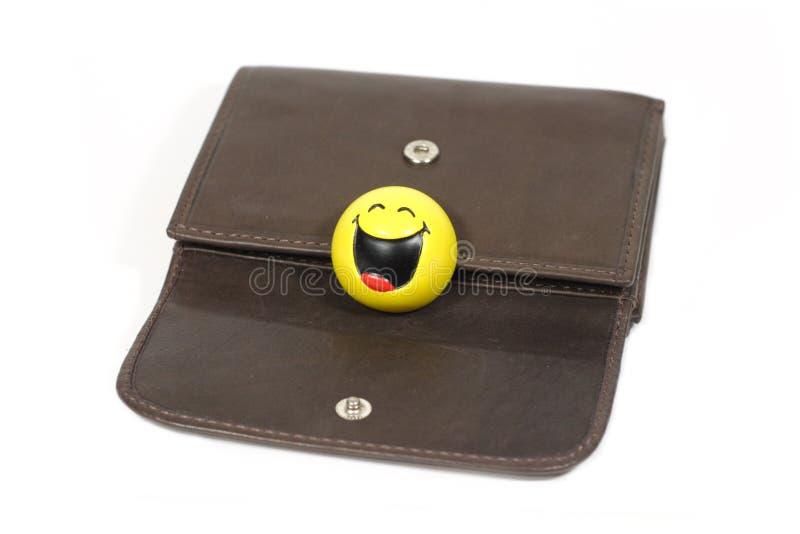 Carteira da cor de Brown com sorriso engraçado fotografia de stock