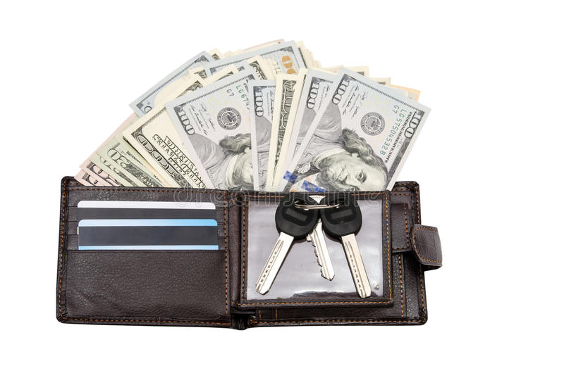 Carteira de couro com cartões e dólares de crédito imagens de stock