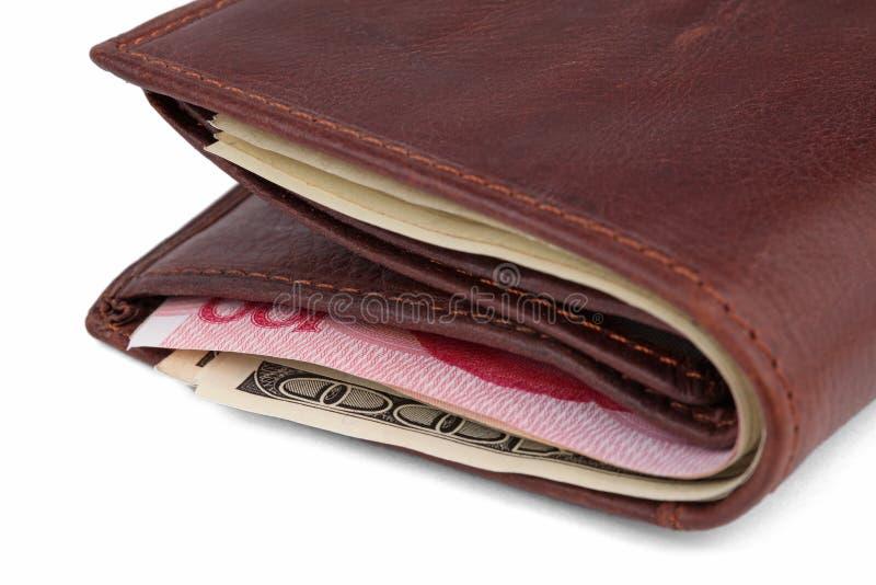 Carteira de couro de Brown com dólares e yuans fotografia de stock royalty free