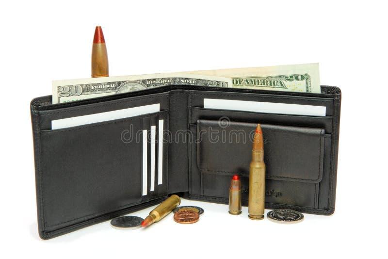 Carteira, dinheiro e cartuchos isolados fotografia de stock royalty free