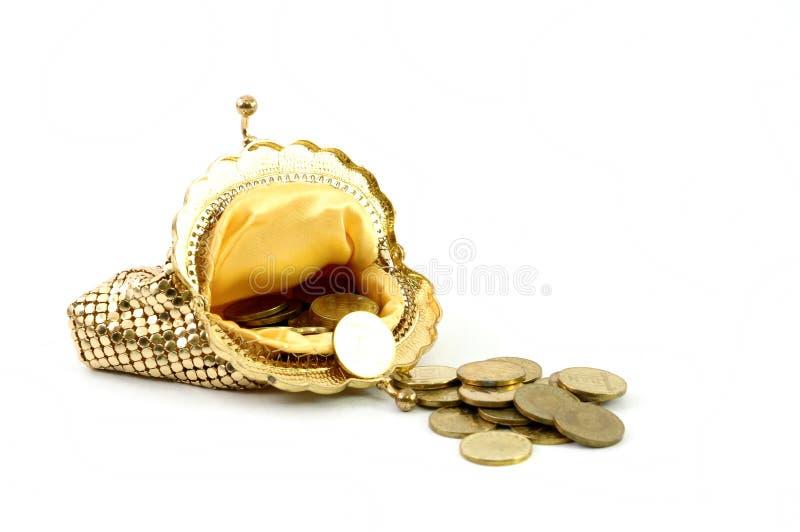 Carteira e moedas douradas fotografia de stock royalty free