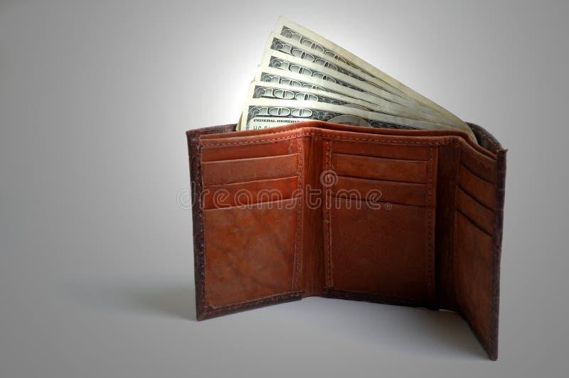 A carteira encheu-se com o dinheiro fotos de stock