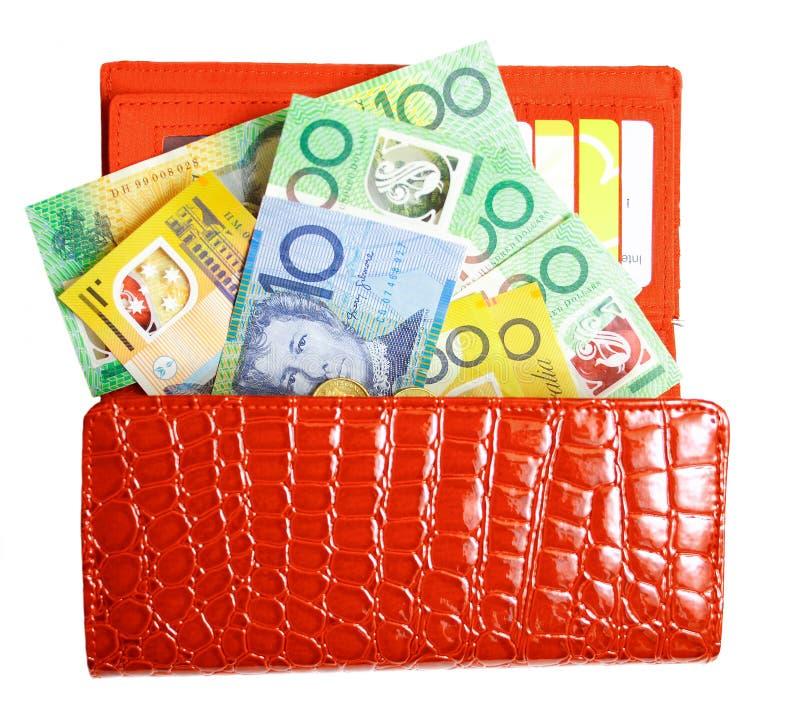 A carteira encheu-se com os dólares australianos fotos de stock
