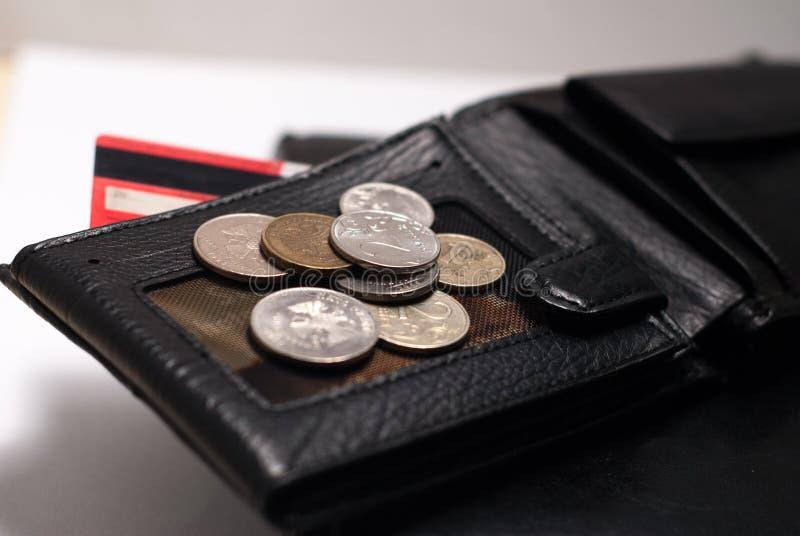 Carteira preta, diário de couro e moedas imagem de stock