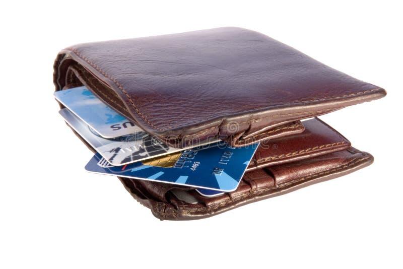 Carteira velha com cartões de crédito para dentro imagens de stock