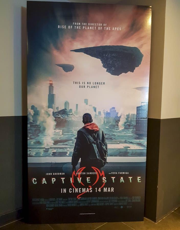 Cartel de película del estado de Captitve Esta película está sobre conflicto extraterrestre foto de archivo libre de regalías