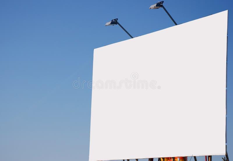 Cartelera en blanco, con iluminaciones encendido foto de archivo libre de regalías