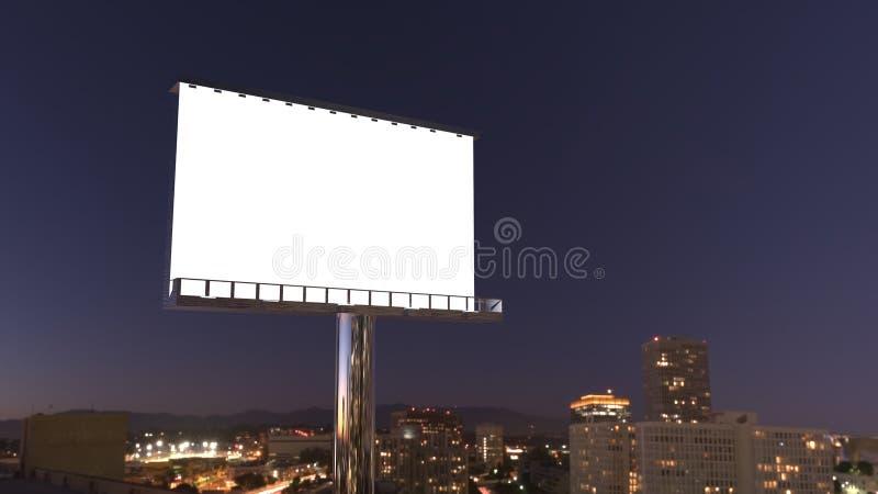 Cartelera en ciudad de la noche imagen de archivo