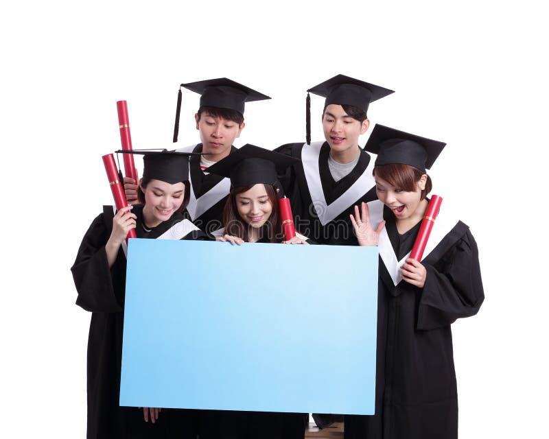 Cartelera feliz de la demostración del estudiante de graduados imagenes de archivo