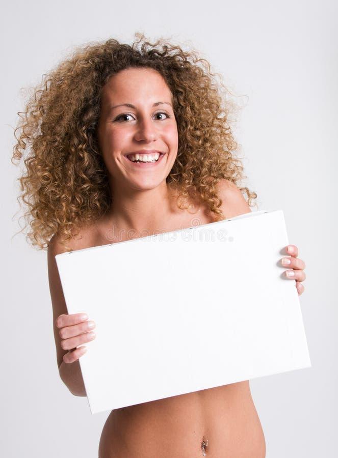 Cartelera sonriente de la muchacha foto de archivo