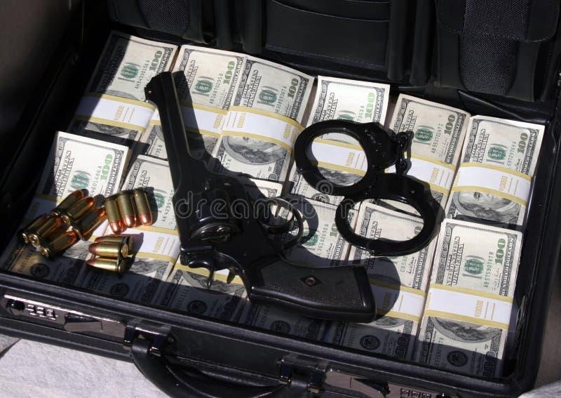 Cartella in pieno di contanti e di soldi fotografia stock