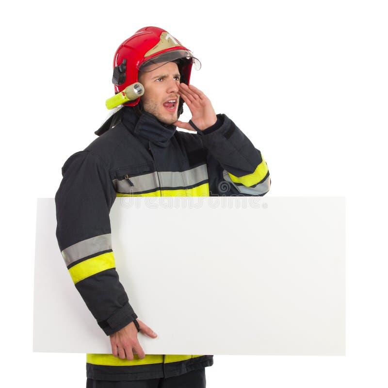 Cartello gridante della tenuta del vigile del fuoco. immagine stock