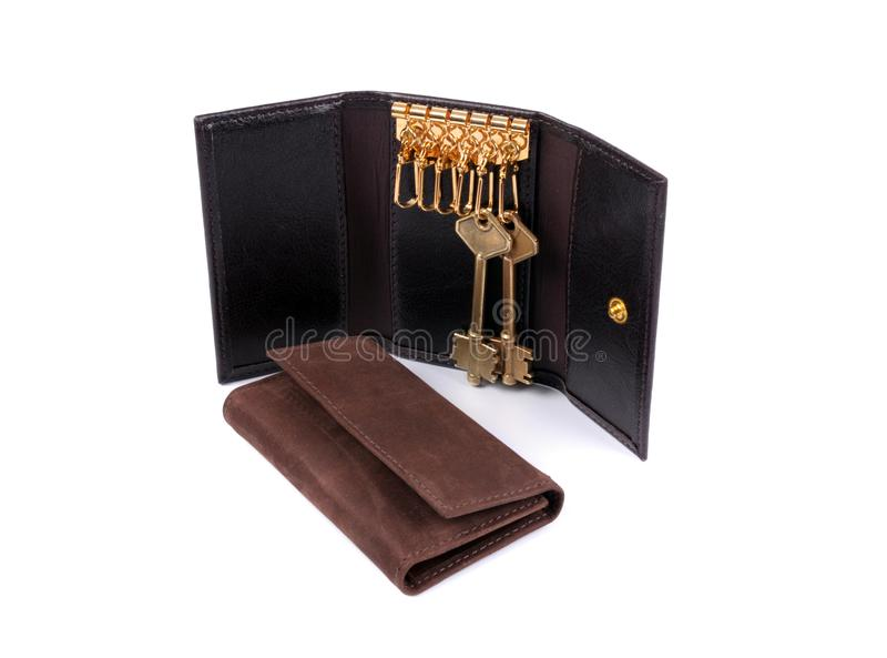 Cartera de cuero del negro y de Brown y tenedor de la llave aislado fotografía de archivo libre de regalías