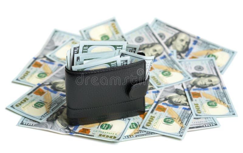 Cartera llena en billetes de dólar imagen de archivo