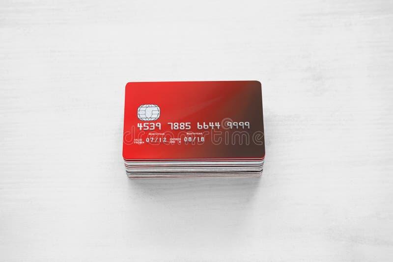 Cartes de crédit sur une table en bois blanche photographie stock