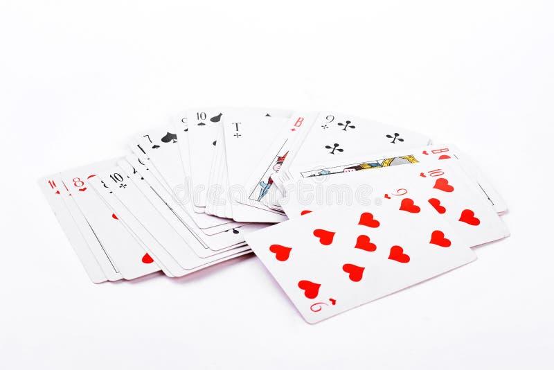 Cartes de jeu sur le fond blanc images libres de droits