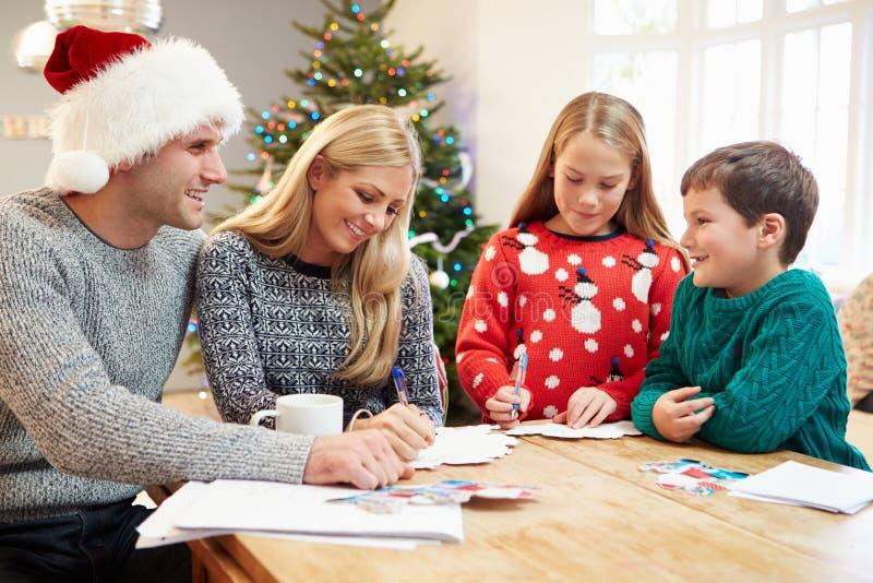 Cartes de Noël d'écriture de famille ensemble photos stock
