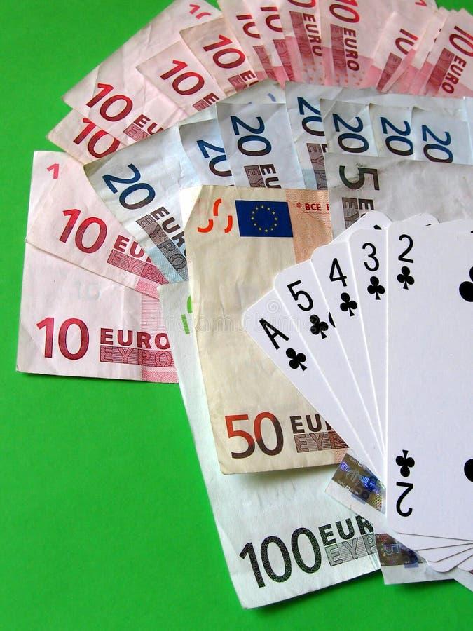 Cartes et argent photographie stock