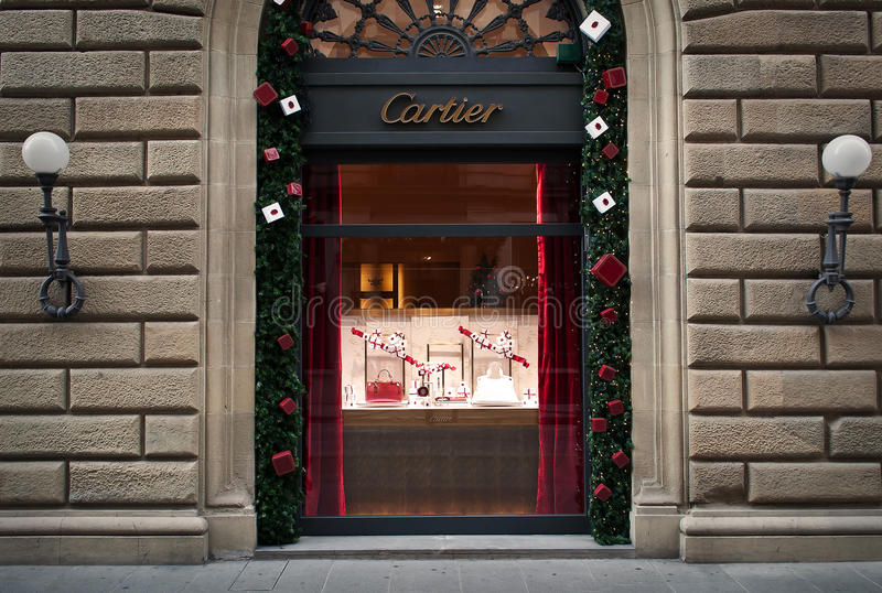 Cartier store window. Cartier store in the center of Florence,Italy. This store is in the palace from 15th century .Windows are decorated for Christmas.... Soci stock image