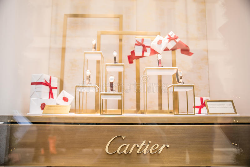 Cartier window shop. MILAN,ITALY - DECEMBER 30, 2014: Cartier window shop.Cartier is a world famous clock and jewelery brand royalty free stock images