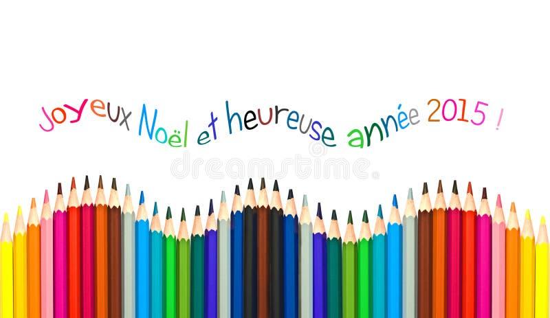 Cartolina d'auguri con testo francese che significa la cartolina d'auguri 2015, matite variopinte del buon anno immagine stock libera da diritti