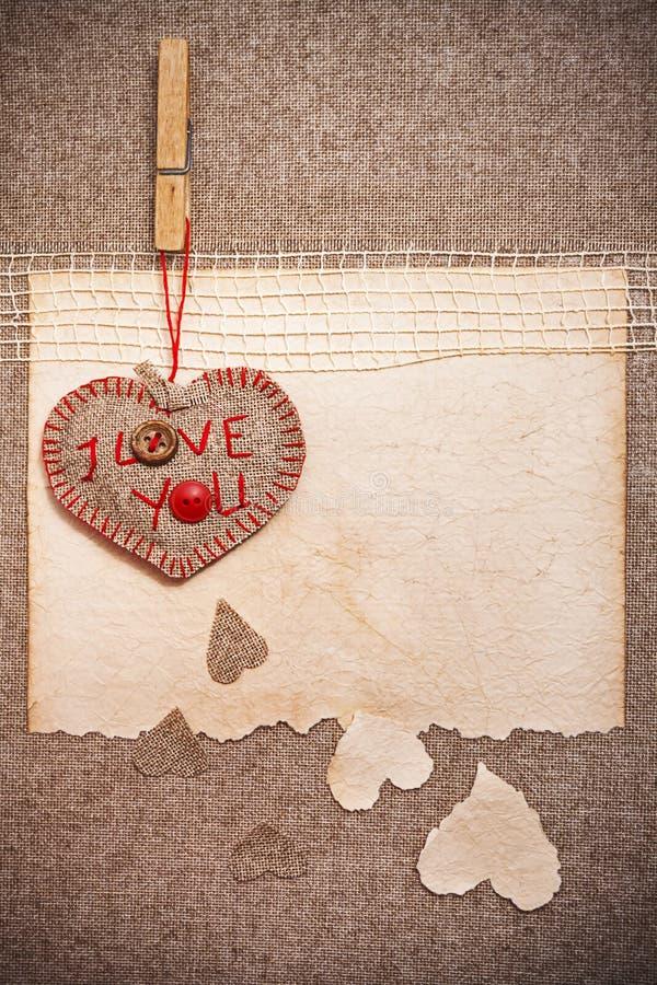 Cartolina d'auguri di arte sul fondo dell'annata con cuore, vecchio documento, f fotografia stock