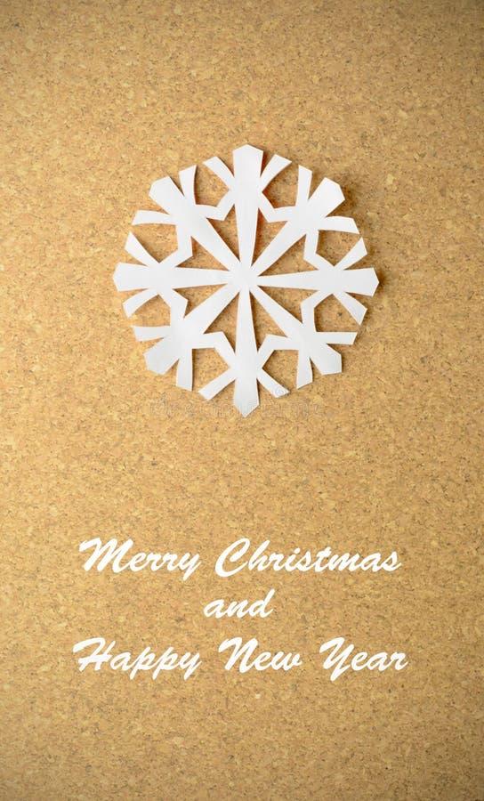 Cartolina di Natale con il vero fiocco di neve di carta immagine stock