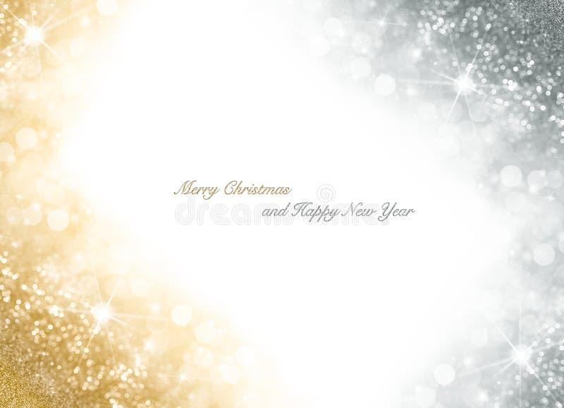 Cartolina di Natale con oro luminoso e fondo frizzante d'argento immagine stock libera da diritti