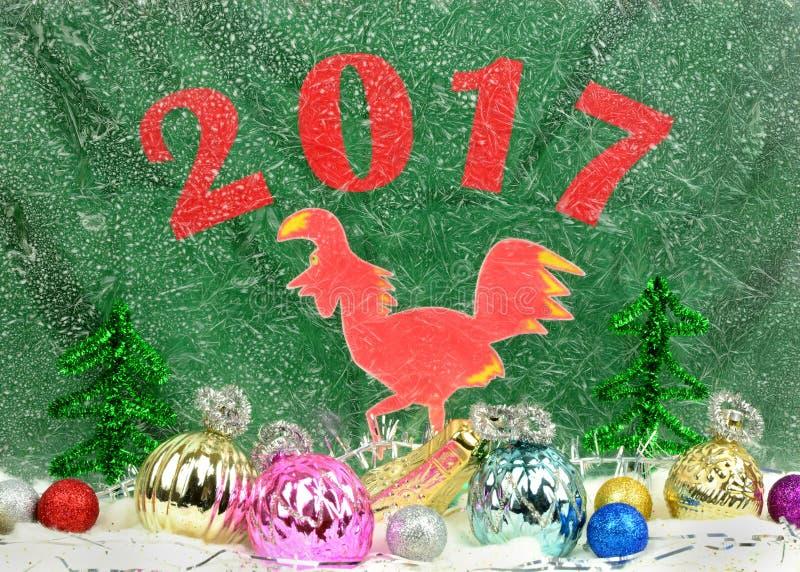 Cartolina di Natale con un gallo rosso fotografie stock libere da diritti