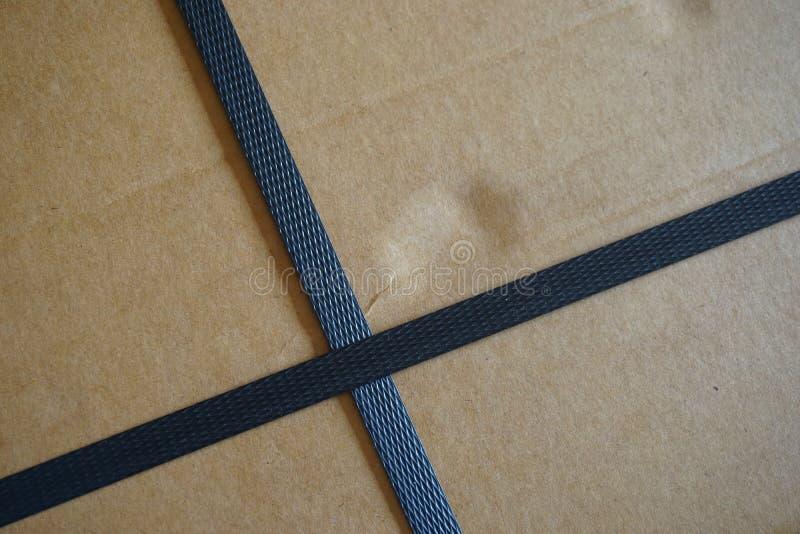 Carton box with straps royalty free stock photos