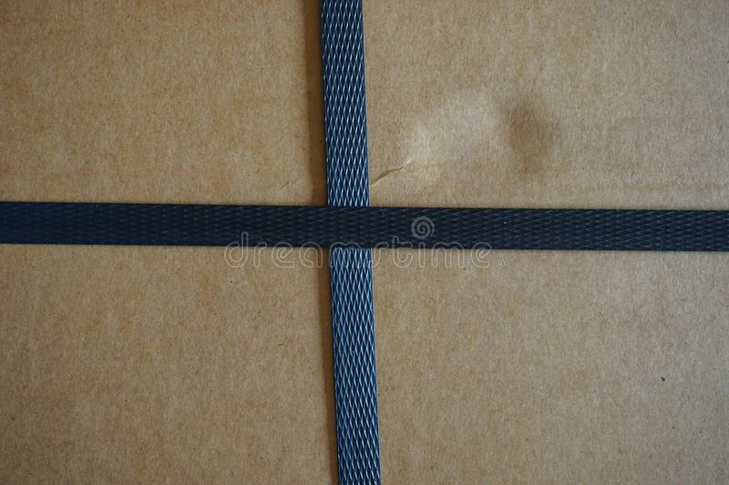 Carton box with straps stock photography