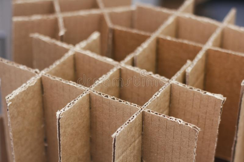 Carton boxes for bottles. Cardboard empty packaging. Waste recycling. Craft Paper parcels. Boxes for protect bottles in shipping process. Carton boxes for royalty free stock images