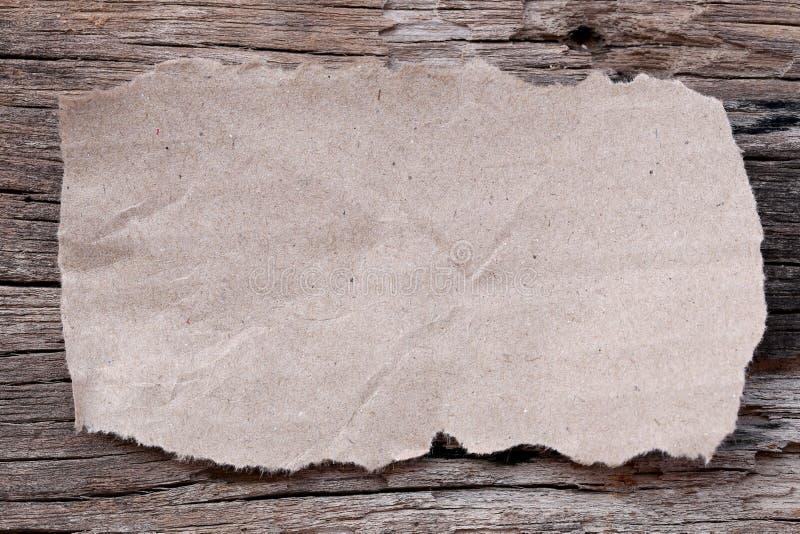 Carton de larme de Brown sur le vieux plancher en bois images libres de droits