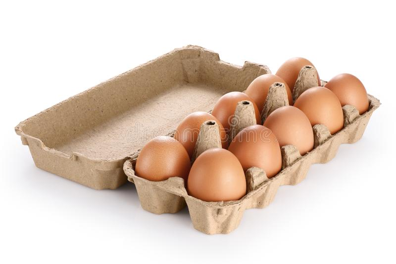 Carton egg box with eggs isolated on white background. royalty free stock photography