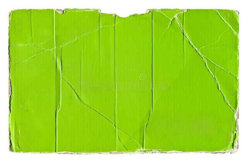 Carton ondulé déchiré par vert image stock