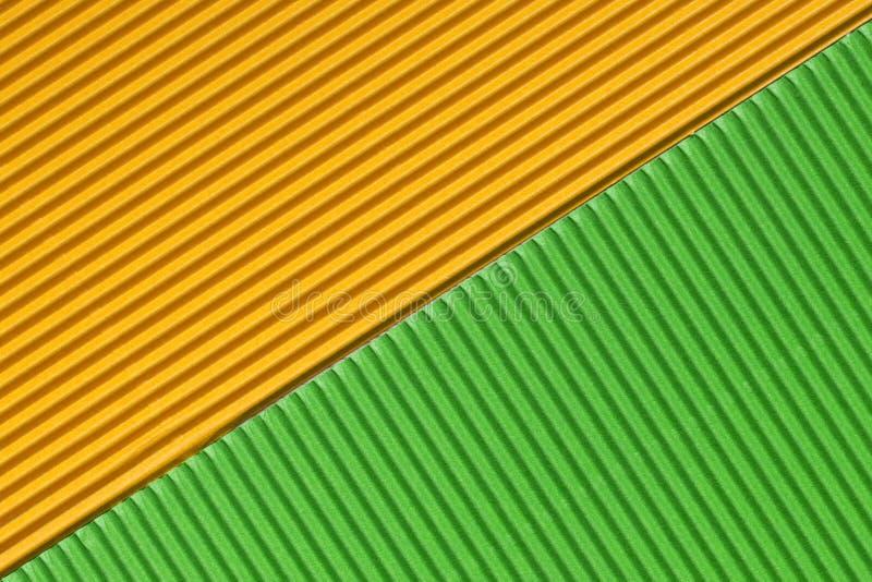 Carton ondulé jaune et vert coloré texturisé photo libre de droits