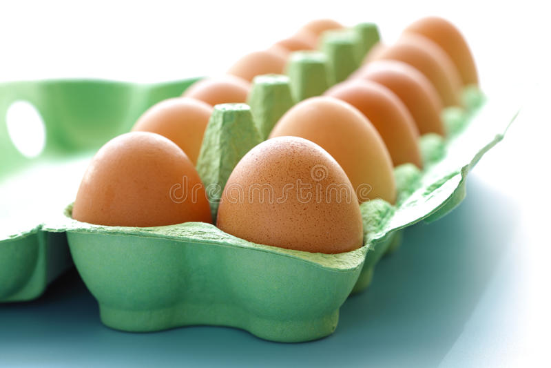 Carton of raw eggs. Egg carton containing a dozen eggs fresh free range eggs royalty free stock photos
